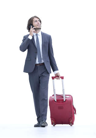 successful businessman with travel suitcase