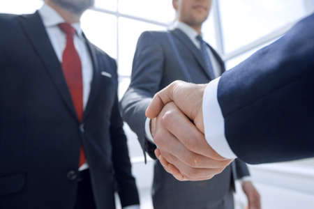 bottom view.businessman reaching out for a handshake. the concept of cooperation