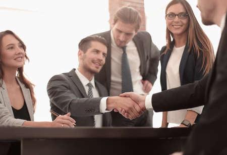 Handshake between employees after the meeting