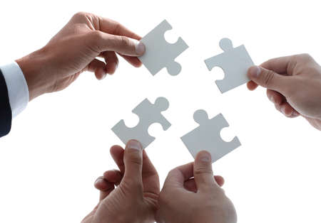 businessman people assembling jigsaw puzzle, team support and he 版權商用圖片