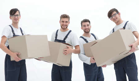 Workers holding boxes when moving flats, Banco de Imagens