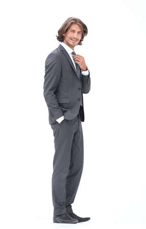 businessman straightening his tie isolated on a white background Banco de Imagens