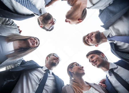 bottom view.a group of business people is forming a circle Imagens