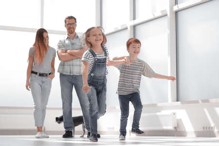 happy family standing in new spacious apartment