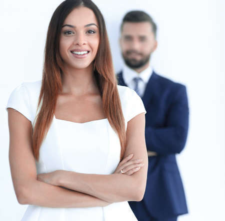 portrait of a business woman while the man is in the background Banco de Imagens