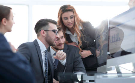 employees discussing financial charts Stock Photo