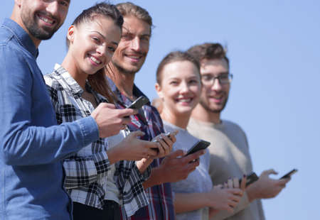 group of young people with modern smartphones. Archivio Fotografico