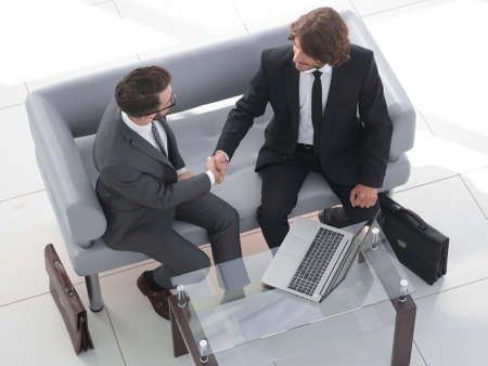 view from the top. handshake business colleagues.