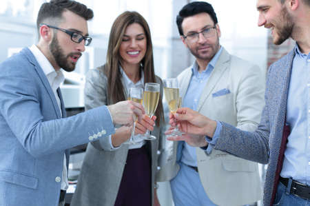 close up.glasses of champagne in the hands of the business team.
