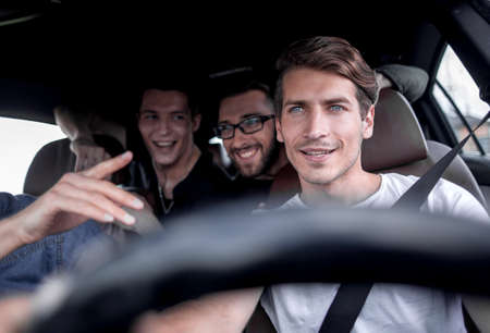 A group of people inside a car, on a road trip Stockfoto - 115580960