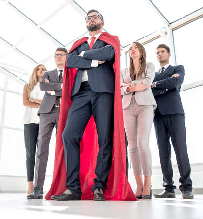 leader in the red cloak and the business team standing together
