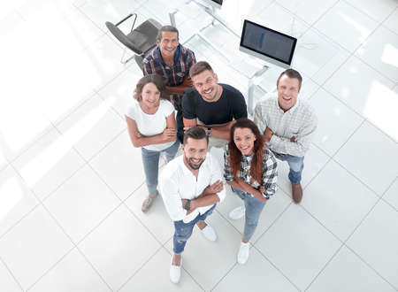 young professionals standing near the desktop Stock Photo