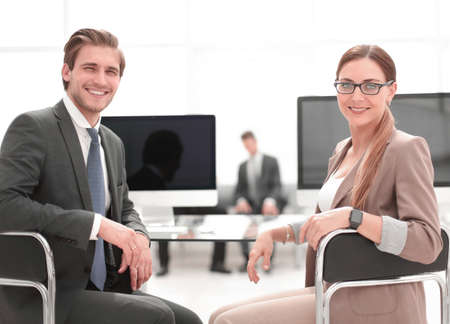businessman and business woman sitting at office Desk Banco de Imagens