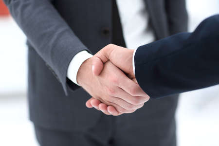close up of two young male business partner shake hand Reklamní fotografie