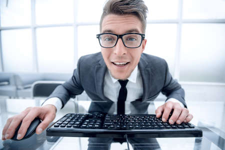 Crazy looking nerdy man typing on the keyboard