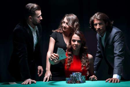People playing poker in the casino, gambling Imagens