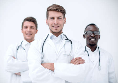 three confident doctors colleagues standing together
