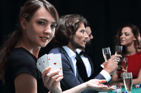 Portrait of the female gambler at the poker table with cards Stock fotó