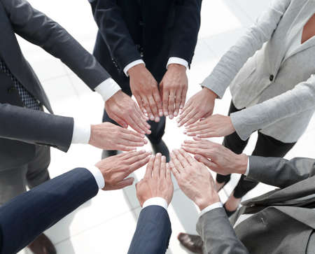 business people giving each other their hands