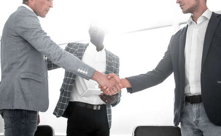 business people shaking hands in a bright office