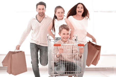happy family with cart and kids 스톡 콘텐츠 - 116914056