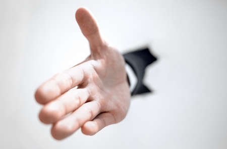 close up. businessman holding out his hand for a handshake Stock Photo