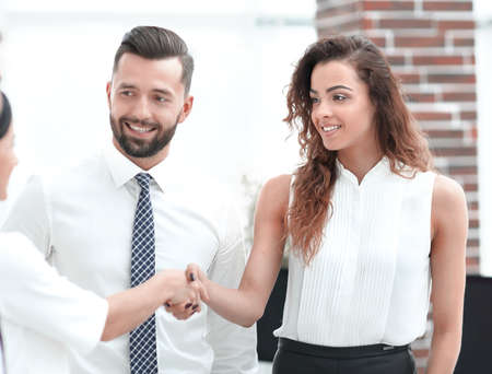 business women greet each other with a handshake Foto de archivo
