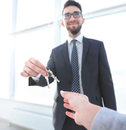 Estate Agent Giving House Keys To a Person