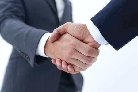 Businessman by handshake invites to cooperation.