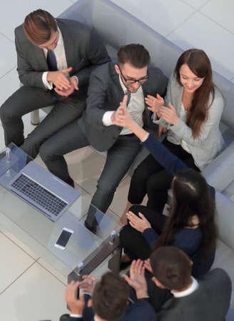 Team of male and female entrepreneurs celebration finishing work