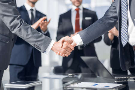 handshake of financial partners in the office.concept of partnership