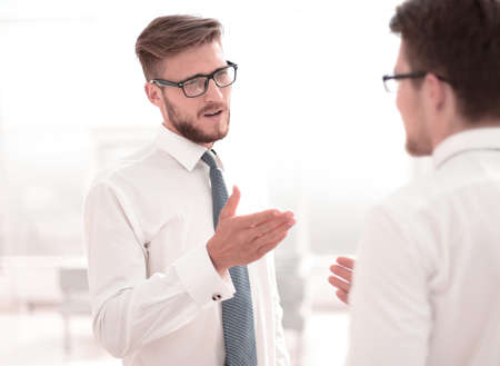 close up. employees discuss their ideas standing in the office Stock Photo