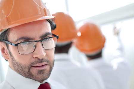 close up.business man in a protective helmet Stock fotó