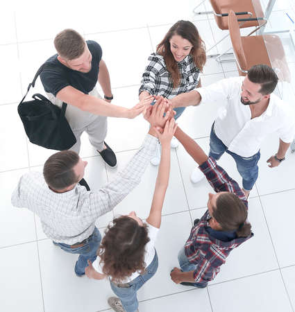 creative team giving each other a high five