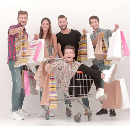 happy group of young people with shopping bags