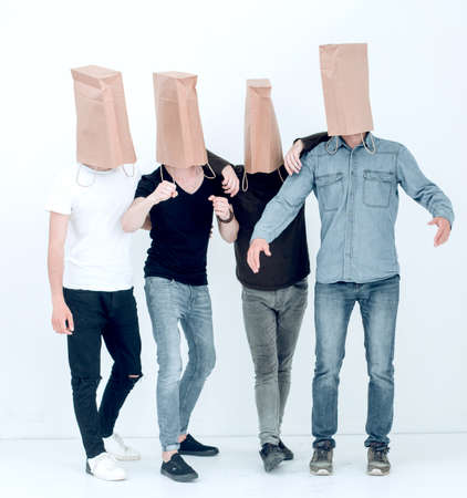 group of young people with paper bags on their heads