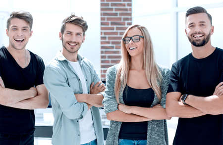 Multi ethnic company of young beautiful friends of girls and guys stand in the office