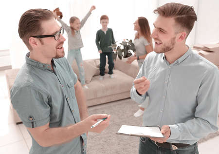 real estate agent and client standing in new apartment