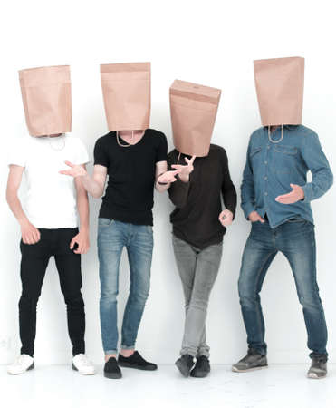 in full growth. a group of young people with paper bags on their heads.photo with copy space