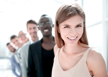 multiethnic corporate business people standing on office looking at camera smiling
