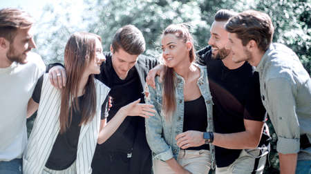 group of young people are discussing something