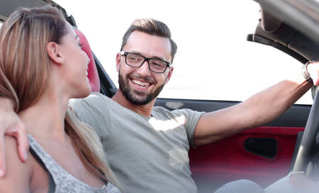 close up.newlyweds traveling in a convertible car