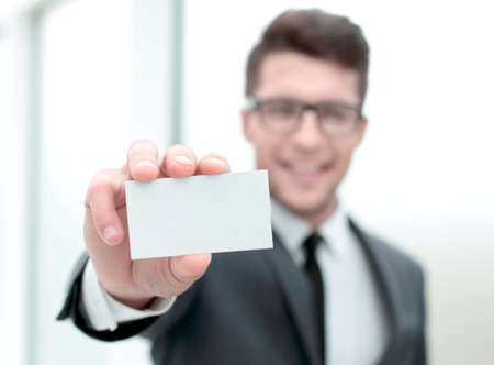 close up.successful businessman showing his business card