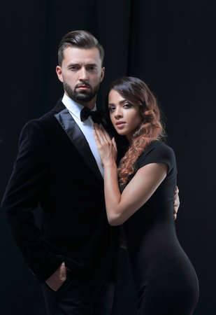 portrait of fashion couple on black background 스톡 콘텐츠