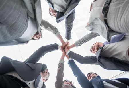 bottom view. business team showing their unity