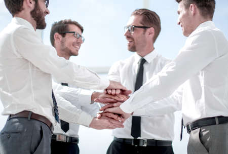 close up.a group of business people folded their hands together Фото со стока