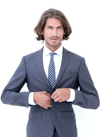 Junger hübscher Geschäftsmann, der sich bückt.