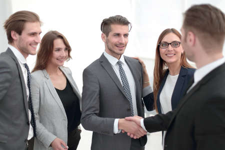 handshake in the lobby of an office building Stockfoto