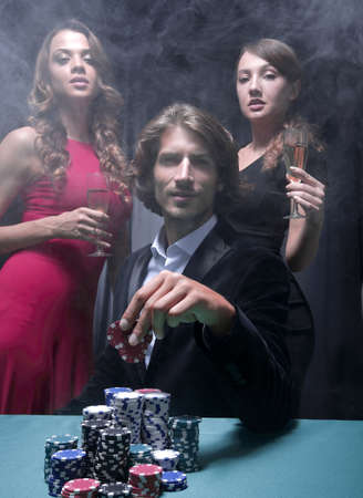 fortunate gambler surrounded by seductive elegant women