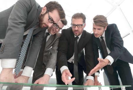 close up.business team standing near the desktop Stock Photo